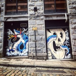 One of Aberdeen's painted doors ups its game with this one. Two doors used to complete one artwork featuring a skull and a blue shark/eel wrapped around it.