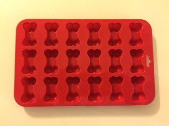 Silicone mold in shape of dog bones for making frozen dog treats