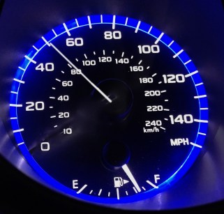 Speedometer with needle just about 50 mph