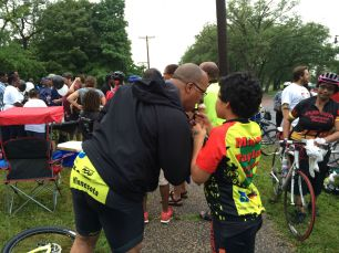 Michael and his son share a cone at the 2015 Slow Roll