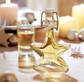 40ml Sternenflasche mit Bügelverschluss. Gefüllt mit einem feinen Weihnachtslikör mit Apfel-Zimt-Geschmack. Zutaten: Weihnachtslikör 20% vol.. Allergiehinweis: Enthält Sulflite<br>