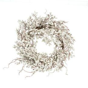 Schöner Dekokranz, der durch seine weiß glänzenden Beeren ein winterliches Ambiente schafft. Maße: ca. Ø 57,5 x Höhe 14 cm, Gewicht: ca. 1,4 kg, Material: Kunststoff, Draht, Schaum.<br>