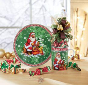 Weihnachtliches Set. Eine Tasse (Ø 10, Höhe 8 cm), ein Kuchenteller (Ø19 cm), 75g Weihnachtspralinen aus Vollmilchschokolade gefüllt mit Nougat-Crisp, Gewicht: ca. 0,9 kg. Zutaten: Zucker, pflanzliches Fett (Palmkern, Kokosnuss), VOLLMILCHPULVER, Kakaobutter, Kakaomasse, MOLKENPULVER, LAKTOSE, knuspriges Getreide 2% (Reismehl, WEIZENMEHL, pflanzliches Öl (Palm), WEIZENGLUTEN, Zucker, WEIZENMALZ, WEIZENDEXTROSE, Salz), fettarmes Kakaopulver, Praliné 1% (Zucker, HASELNUSSMARK), Emulgator: Sonnenblumenlecithine, E476; MAGERMILCHPULVER, Aromen. Allergiehinweis: Kann Spuren enthalten von EIERN und anderen SCHALENFRÜCHTEN<br>