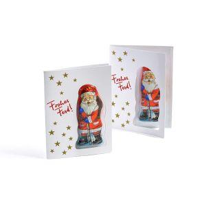In dieser Faltkarte ist ein Vollmilchschokoladen-Weihnachtsmann der Firma Riegelein angebracht. Durch eine Stanzung in der Vorderseite kann man die Figur auch sehen, wenn die Karte geschlossen ist. Im innenteil Raum zum Anbringen von handschriftlichen Weihnachtsgrüßen oder einem Werbeeindruck. Zutaten: Zucker, VOLLMILCHPULVER, Kakaobutter, Kakaomasse, SÜSSMOLKENPULVER, Emulgator: SOJA-Lecithin; Vanilleextrakt. Allergiehinweis: Kann Spuren von Haselnüssen, Mandeln und Gluten enthalten.