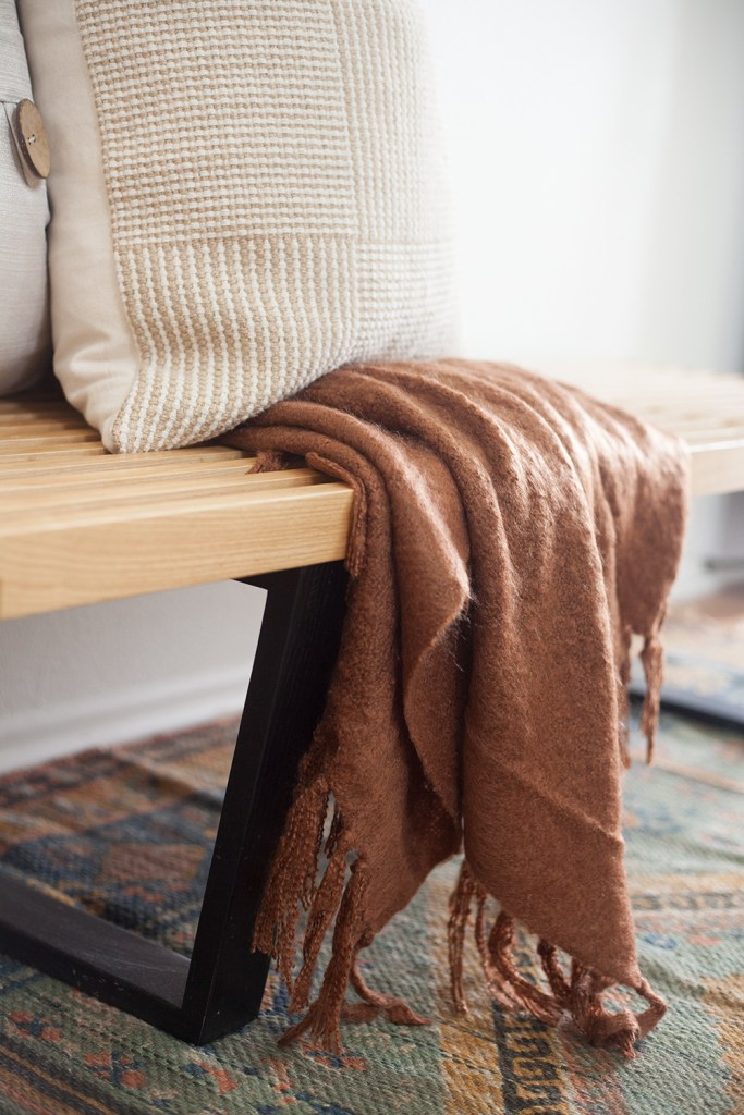 WALMART FALL DECOR by popular interior design blog, E. interiors: image of a brown blanket draped on a bench.