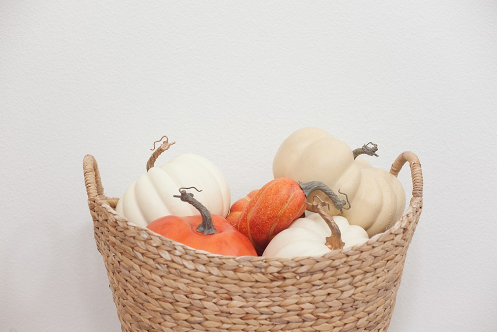WALMART FALL DECOR by popular interior design blog, E. interiors: image of a woven basket filled with pumpkins.