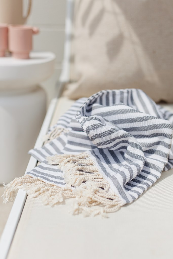 Summer Essentials From Walmart by popular US interior design blog, E. Interiors: image of a grey and white stripe Turkish towel.