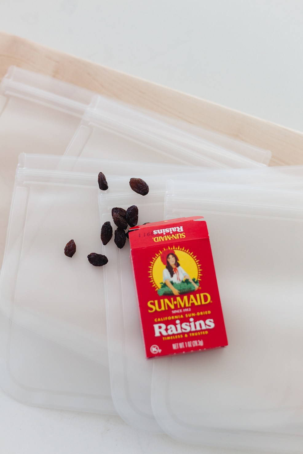 Wow and Now by popular US life an style blog, E. Interiors Design: image of a box of Sun-Maid Raisins resting on top of some re-sealable bags.