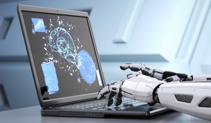 robot typing on computer
