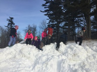 To get to the forest, the kindergarten class scales snowy peaks.