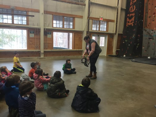 Harness demonstration at the indoor rock wall