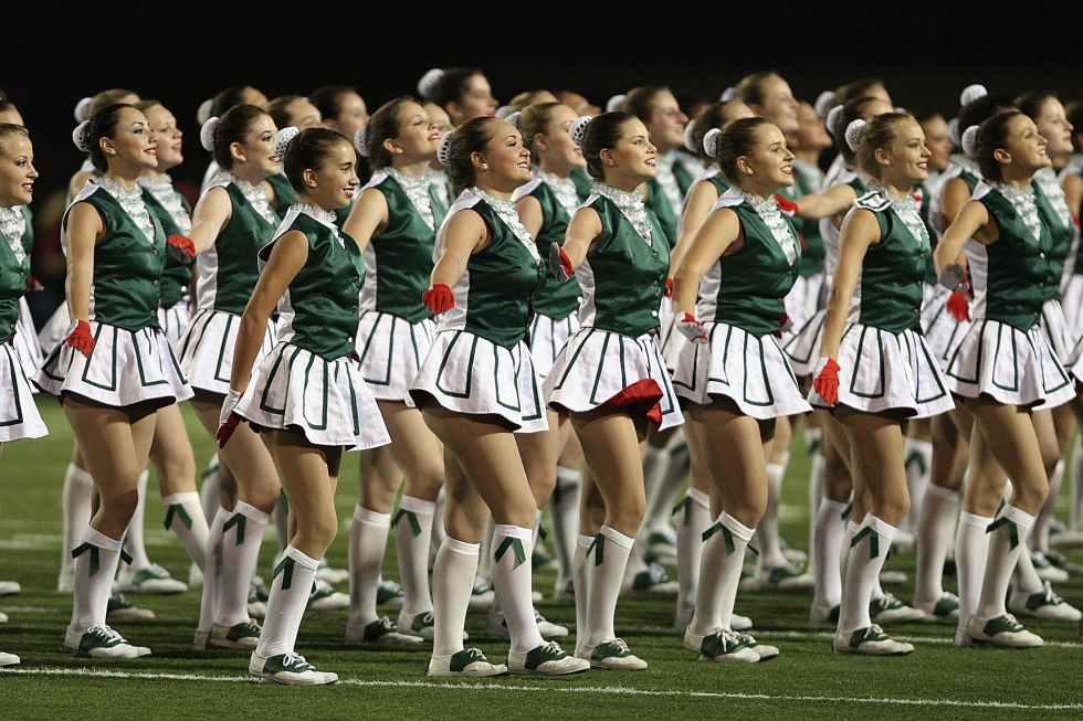 group of cheerleader on green field