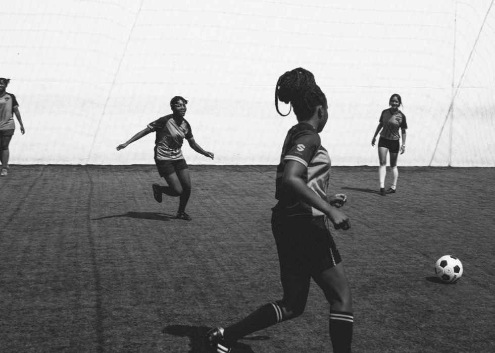 female football team cheerfully playing in football