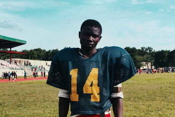 black player of american football on stadium