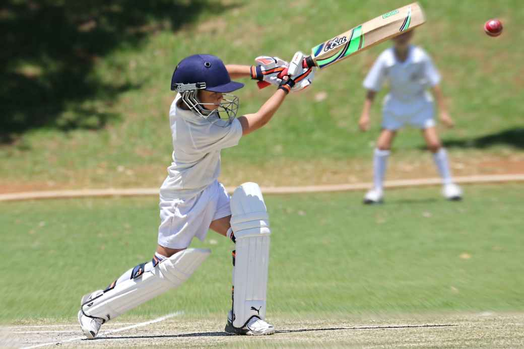 man in white jersey shirt and pants holding cricket bat