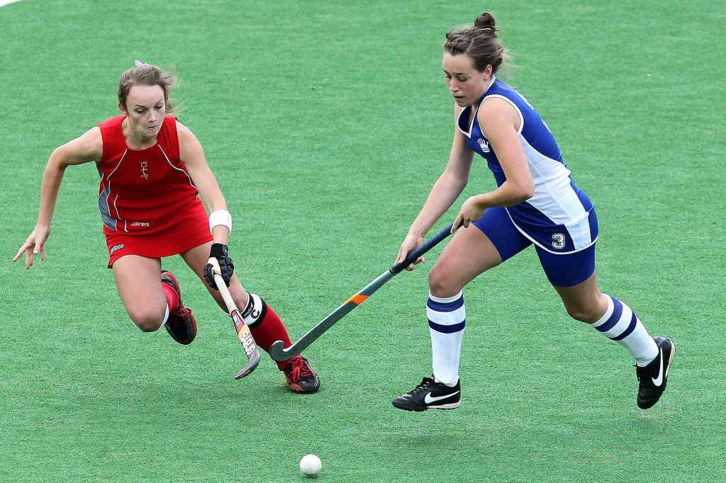 two woman competing for a goal