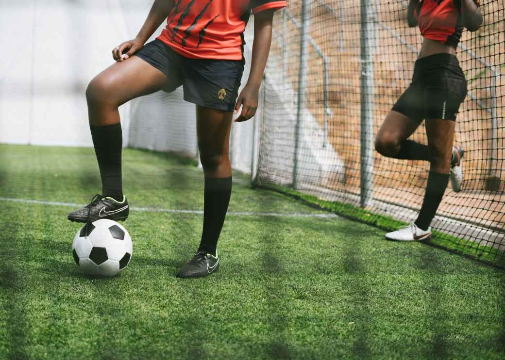anonymous women soccer players in training