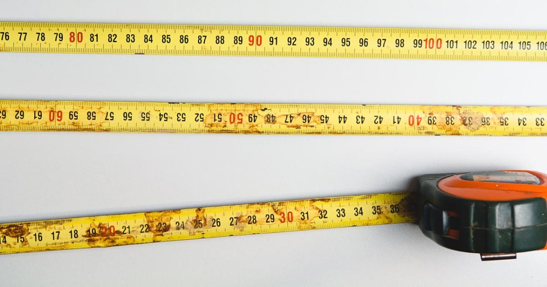 A fully extended tape measure with the yellow strips stacked in a zig zag pattern of three