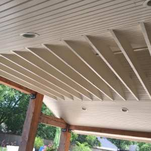 Patio add-on with beadboard ceiling, paint, and speakers.