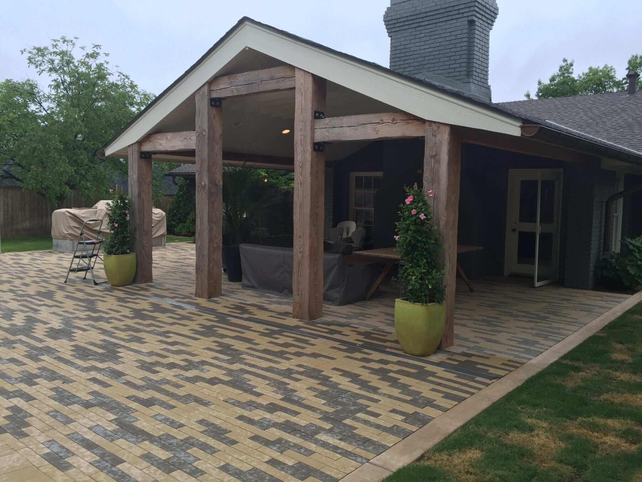 Cedar Posts, extended patio roof, custom pavers, copper gutters, speakers, and paint.