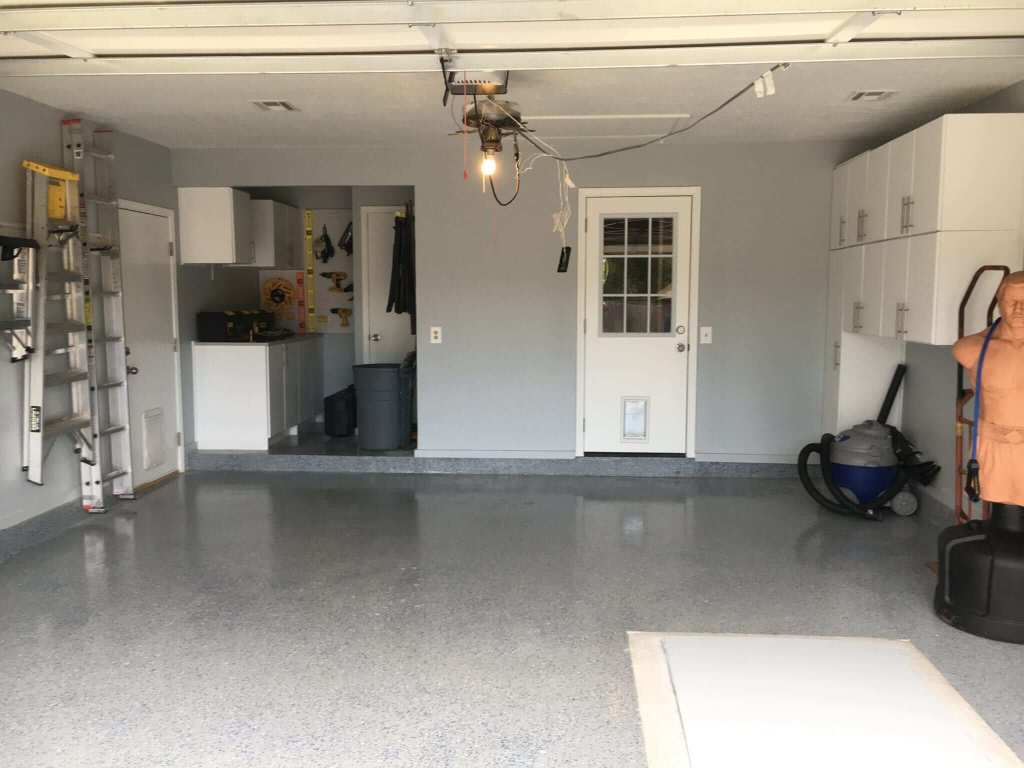 After - Refinished garage floor with epoxy multi-colored flakes.