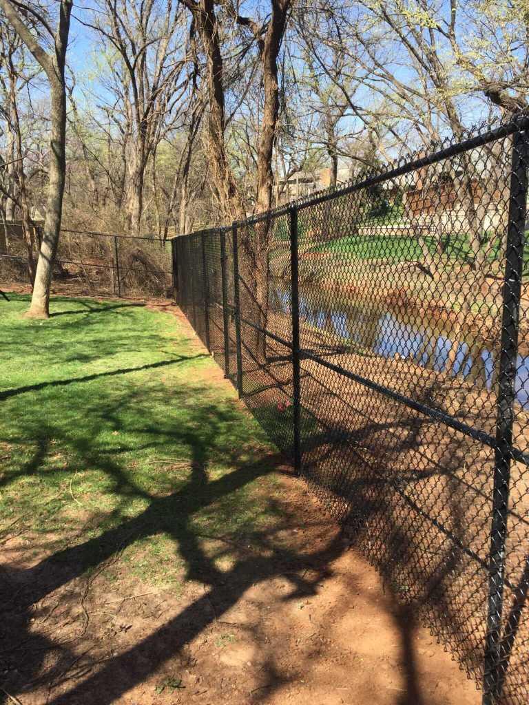 Black 10 foot metal fence.