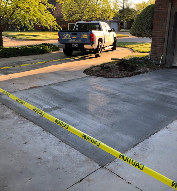 Concrete driveway repair damaged by tree roots.