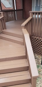 New cedar wood deck repairs with solid stain.