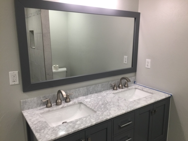 New mirror, vanity, granite, and paint floors.
