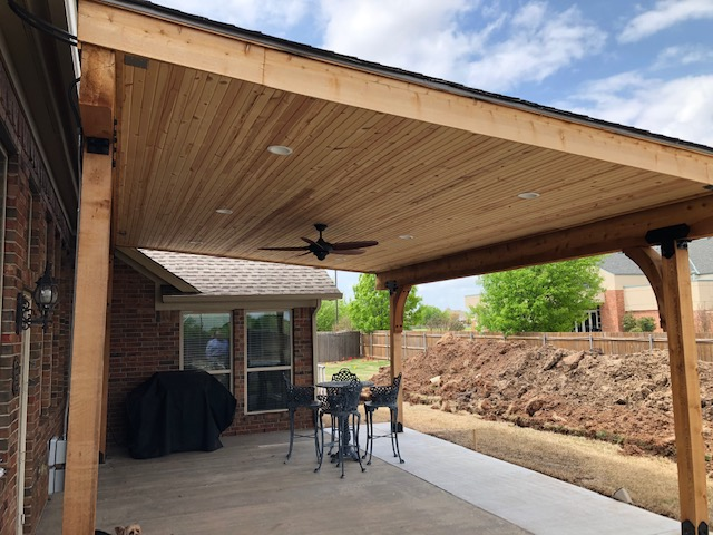 Cedar columns and beams – bead board ceiling – LED lights – fan – asphalt roof