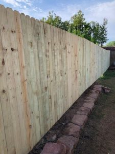 New pine dog-eared 6 foot wood fence.