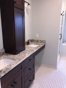 Vanity, Granite, Vanity Lights, Sinks, and Tile Floors.