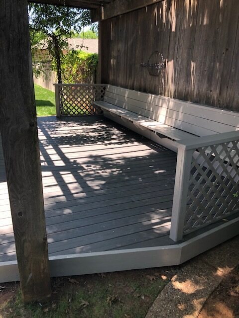 New outdoor synthetic deck and painted wood bench.