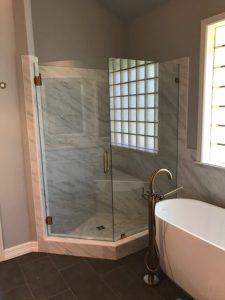 Stand-alone tub, custom gold faucet, frameless shower door, new tile on floor and shower.