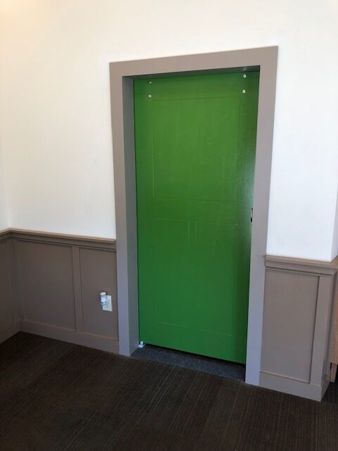 Installed and painted a barn door for a commercial business.