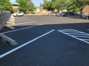New asphalt, parking lot and striping for a fraternity at the University of Oklahoma.