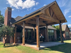 This outdoor cedar patio remodel extended the concrete and added new ceiling fans, outdoor electric and TV hook-up, and gutters.