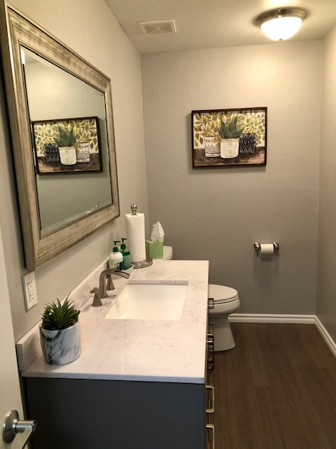 Commercial bathroom remodels with new vanity, toilet, lighting, and drywall repairs.