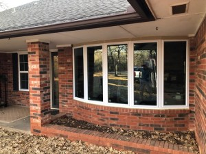 New vinyl low-e single hung windows with picture bay windows.