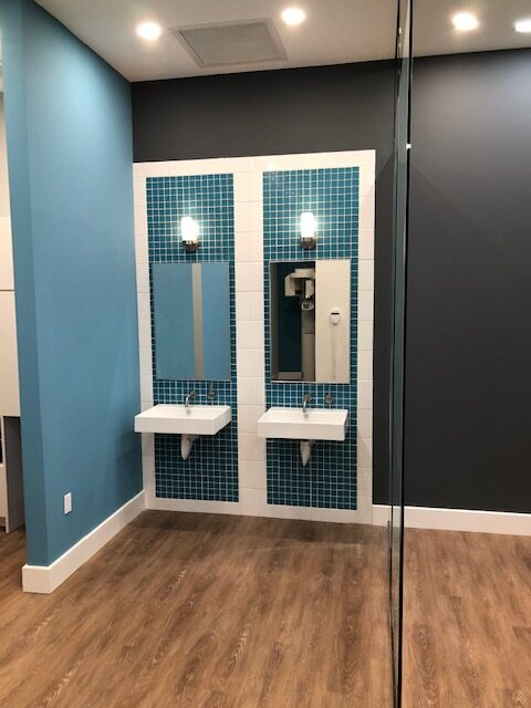 This complete commercial remodel included new custom backsplash tile, paint, floors, glass walls, and lighting.