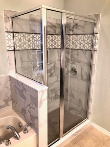 New tub and shower tile. New glass door. Custom border inlay tile. Schluter system.