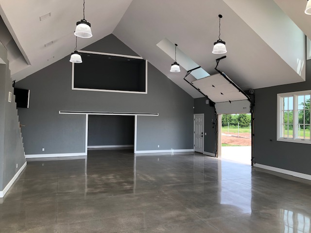 "Brand new ground up construction of a spectacular ""man cave"".   Polished cement floor.   20 foot ceilings.   Custom garage doors.   On and on!!"