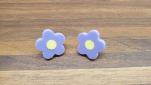 lavender daisy studs with yellow centres