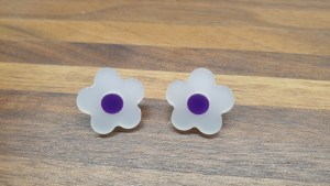 frosted white daisy studs with purple centres
