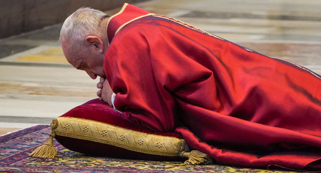 Pope Francis Prostrates On Floor For Good Friday