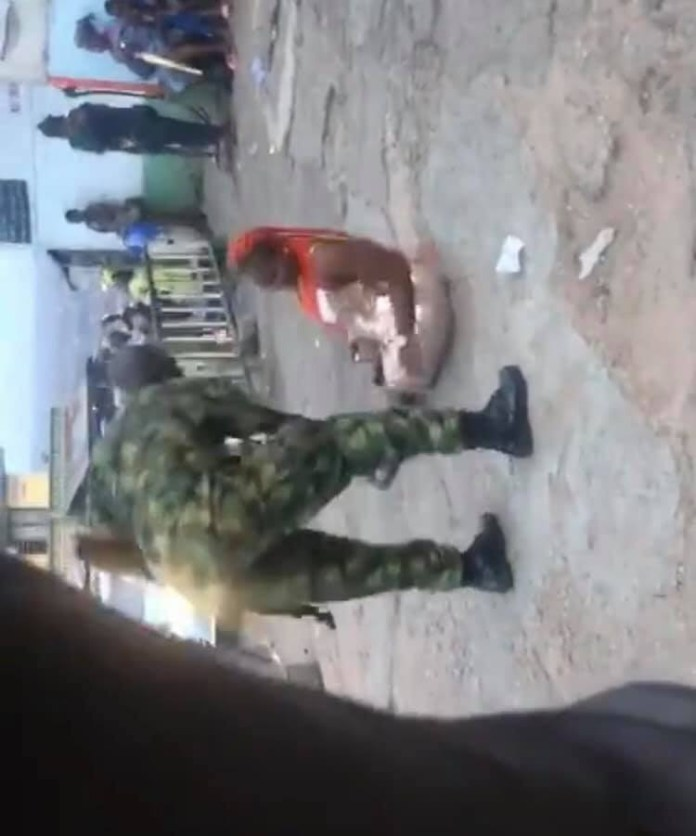 Opeation Beast: Soldier seen beating a woman in Ibadan for 'indecent' dressing, cuts the hair of some passers-by after allegedly harassing and extorting them (videos)