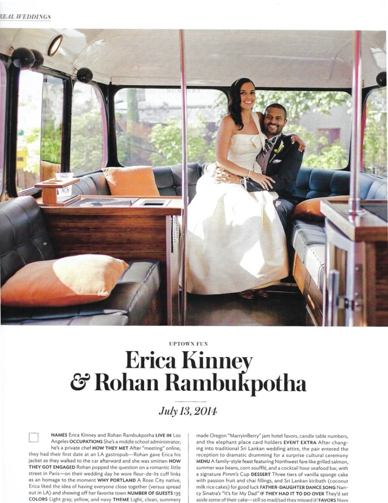 a wedding couple poses together in the window of a double-decker bus