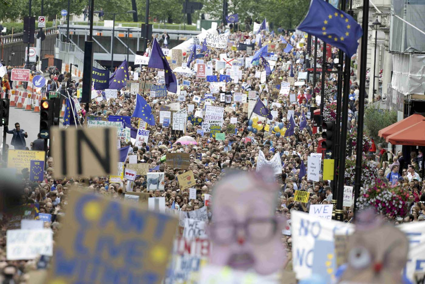 People hold banners during a demonstration against Britain's decision to leave the European Union, in central London, Britain July 2, 2016. Britain voted to leave the European Union in the EU Brexit referendum. REUTERS/Paul Hackett