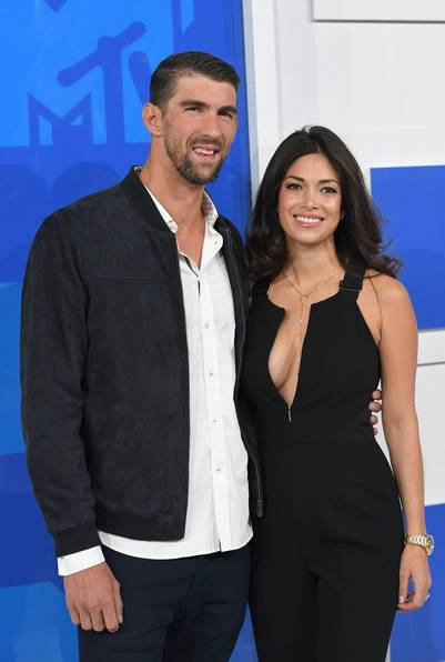 Michael Phelps y la modelo Nicole Johnson.