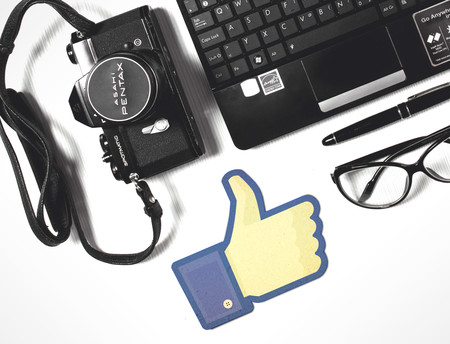 Stockvault Facebook Thumbs Up With Laptop And Camera183705